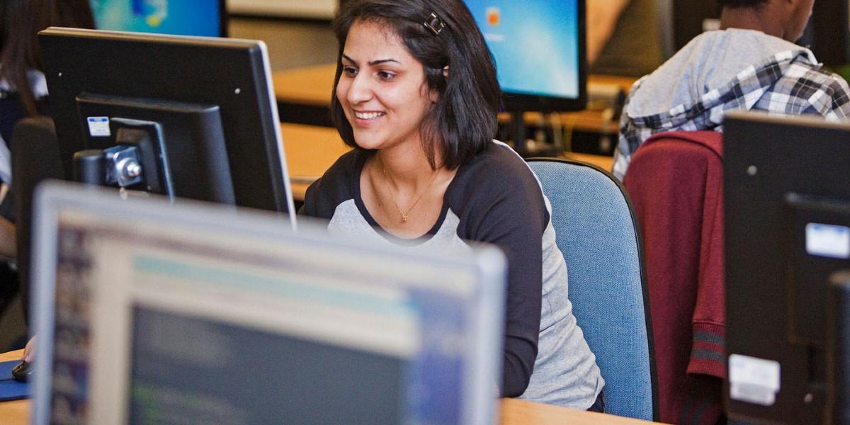 Students looking at computer