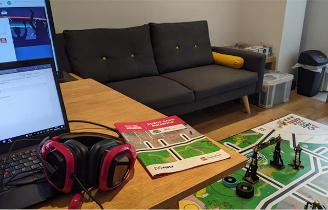 A laptop, pair of headphones and lego tournament