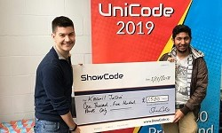 Kaamil Jasani receiving his prize money from Oliver Slot, Head of Marketing and Communications at ShowCode