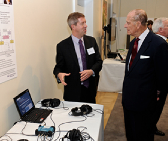 Dr Josh Reiss shows HRH The Duke of Edinburgh his work on automatic music production systems.  Image taken from: http://www.raeng.org.uk/events/gallery/default.htm?Event=naming_ceremony_2012&Page=2